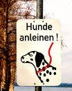 Dog leash sign take the on a germany Stock Photos