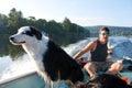 Dog loves fishing boat Royalty Free Stock Photo