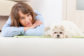 Dog and owner little maltese laying with his on the floor in home Stock Photo