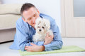 Dog and owner little maltese laying with his on the floor in home Royalty Free Stock Photography