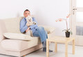 Dog and owner little maltese sitting with his on the sofa in home Royalty Free Stock Photography