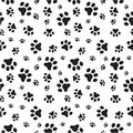Dog paws seamless pattern a random sized of dogs silhouettes Stock Photography