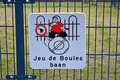 Dog (pets) walking place as warning sign on metal grid, environm Royalty Free Stock Photo