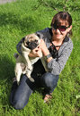 Dog Pug and young woman Royalty Free Stock Photo