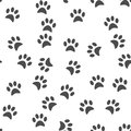 Dog's paw print background. Seamless pattern.