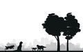 Dog silhouettes on a cityscape Royalty Free Stock Images