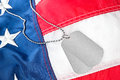 Dog tags on American flag Stock Photography