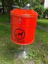 Dog waste trash bin red Royalty Free Stock Photo