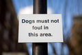 Dogs must not foul sign on a post that says in this area Stock Photography