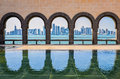 Doha skyline through the arches of the museum of islamic art do seen at qatar Royalty Free Stock Image