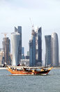 Doha skyline a pair of dhows moored in bay qatar with the arabian capital city s new high rise behind them during flag high rise Stock Photo