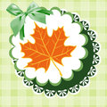 Doily autumn leaves on a green napkin with a bow Stock Photo