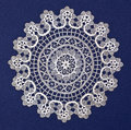 Doily duodecies handmade on blue background Royalty Free Stock Photography