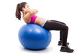 Doing crunches on exercise ball athletic and strong young woman some an a white background Royalty Free Stock Photos