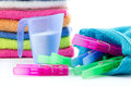 Doing the laundry colorful towels measuring cup filled with soap powder and clothes pegs isolated Royalty Free Stock Image