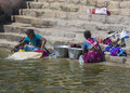 Doing laundy on the steps of the holy tank kumbakonam india october two women are laundry sacred maha maham downtown they are Stock Photo