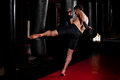 Picture : Doing some kicks on a punching bag press space white