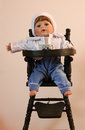 Doll a baby sitting in a high chair Royalty Free Stock Photography