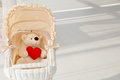 Doll buggy vintage with teddy bear and red heart Royalty Free Stock Photo