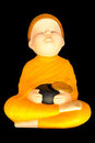 Doll clay baby monk meditation with  alms bowl Stock Image
