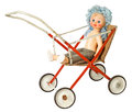 Doll in pram dirty isolated on white background Stock Images