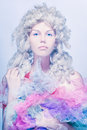A doll or a princess. Cold tones photo. Royalty Free Stock Photography
