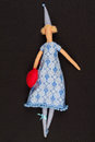 Doll with red bag