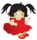 Doll in a red dress Royalty Free Stock Image