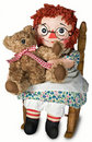 Doll with teddy bear Stock Images
