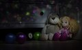 Doll and teddy rabbit floor in children s room watches balls on the the at night toys a dark Stock Image