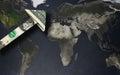 Dollar arrow on a world map Royalty Free Stock Photo