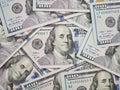 100 dollar bill surrouded by new 100 dollar bills Royalty Free Stock Photo