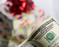 Dollar bills bill against gift box Royalty Free Stock Photos