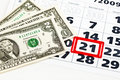 Dollar bills on calendar Stock Image