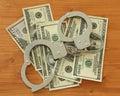 Dollar bills with handcuffs Stock Image