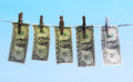 Dollar bills hanging on a clothesline Royalty Free Stock Photography