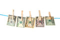 Dollar bills hanging rope wooden pegs Stock Images