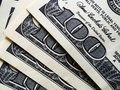 100 dollar bills stacked on the table, close-up Royalty Free Stock Photo