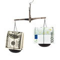 Dollar and the euro in the balance Stock Photos