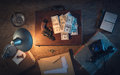 Dollar packs and gun vintage desktop in the dark with a a briefcase a lot of top view Stock Photography