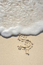 Dollar Sign Drawn in Sand on Beach Stock Images