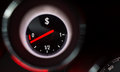 Dollar sign fuel gauge nearing empty Stock Photo