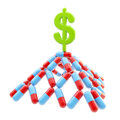 Dollar sign at the top of pills pyramid made medical isolated on white Royalty Free Stock Images