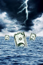 Dollar sinking damaged and banknotes Royalty Free Stock Photography