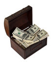 Dollars banknotes in trunk. Isolated on white Royalty Free Stock Photo