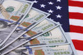 Dollars banknotes on usa flag close up of one hundred Royalty Free Stock Photography
