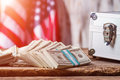 Dollars, case and USA flag. Royalty Free Stock Photo