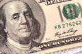 Dollars closeup. Benjamin Franklin portrait on one hundred dollar bill Royalty Free Stock Photo