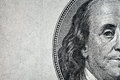 Dollars closeup detail of benjamin franklin s portrait on one hundred dollar bill Royalty Free Stock Photo