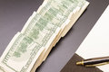 Dollars with a copybook lots of an open Royalty Free Stock Photo
